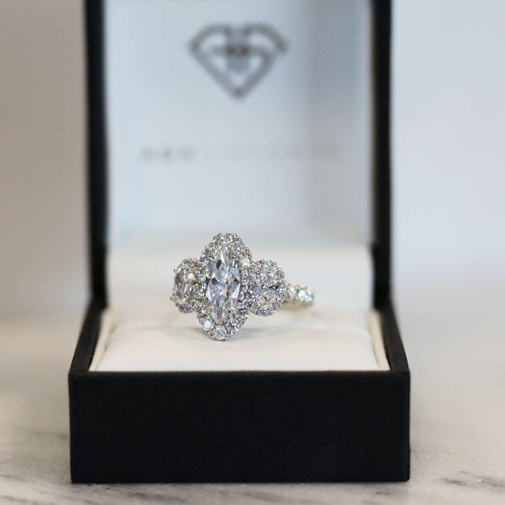 Marquise Three Stone Halo Ring.jpg