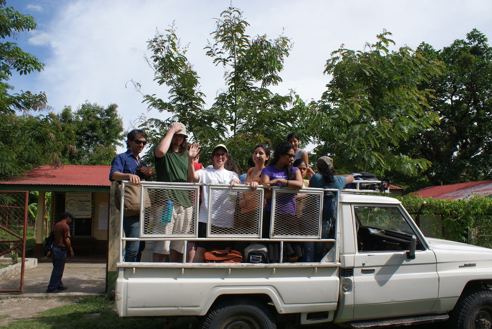 Students riding in truck to rural clinic.