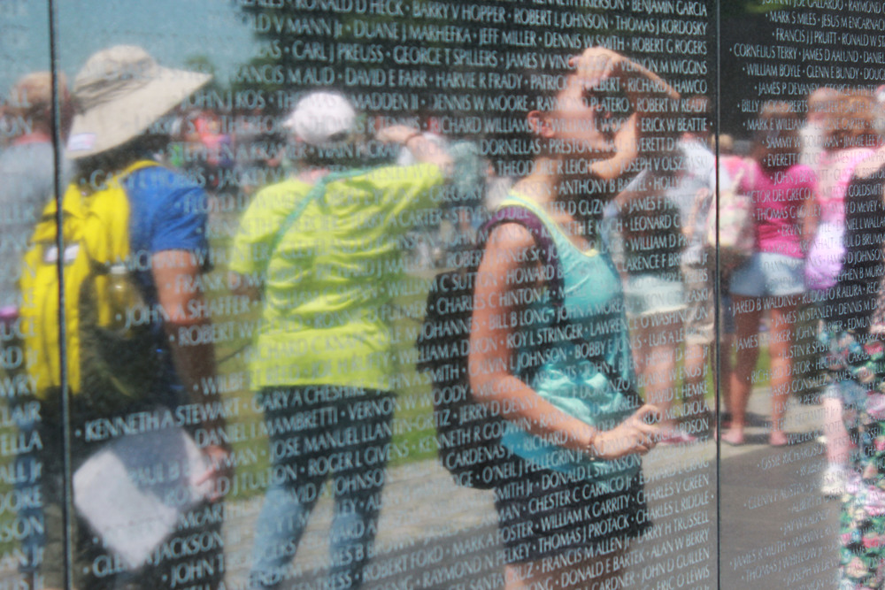 Jacqueline observing the Vietnam War Veterans Memorial.