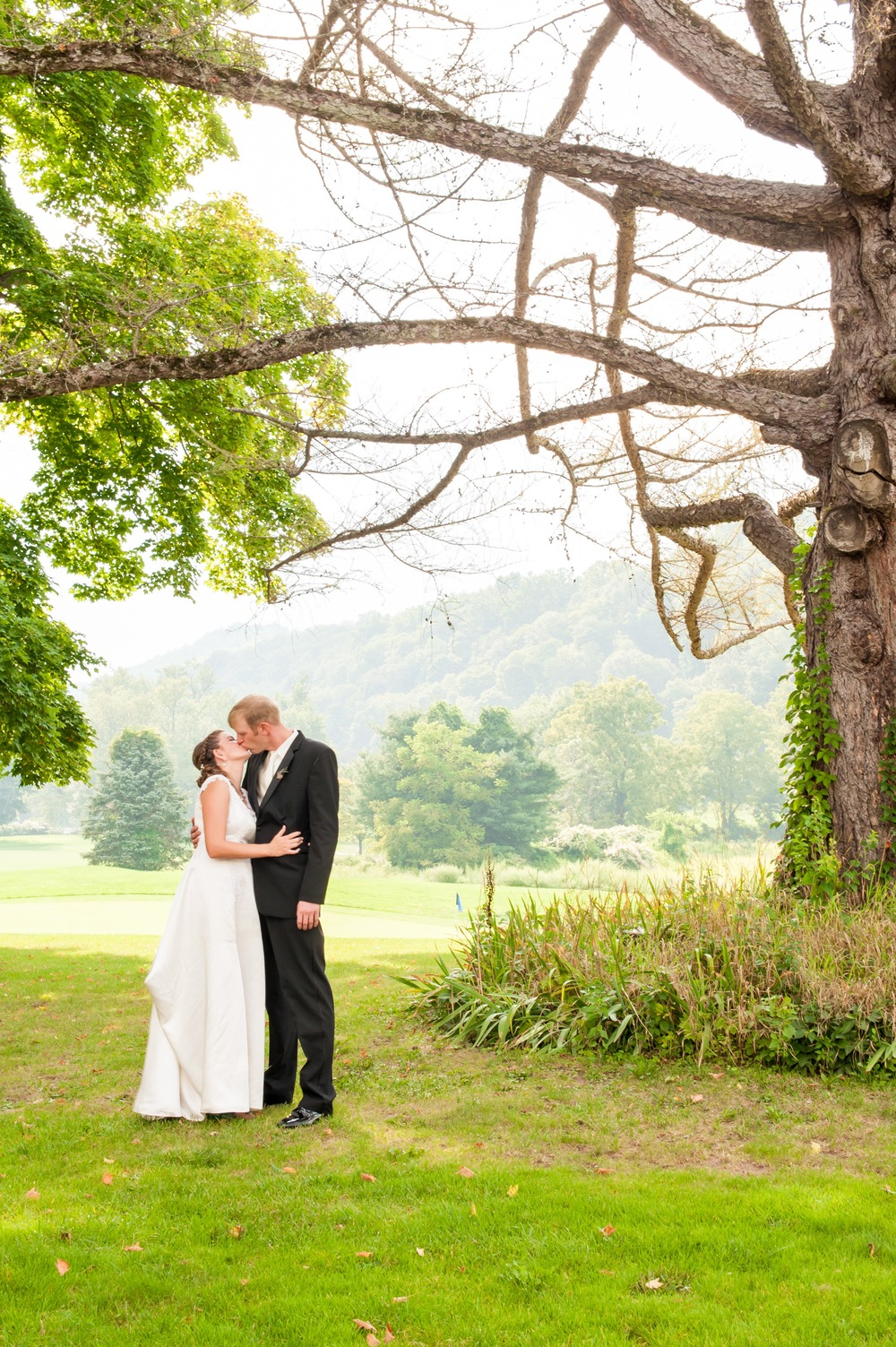 Bride and Groom Under Tree at Shawnee Inn, Pennsylvania