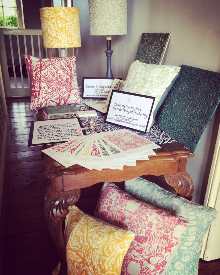 Sample cards, cushions, lampshades and sketchbooks on display
