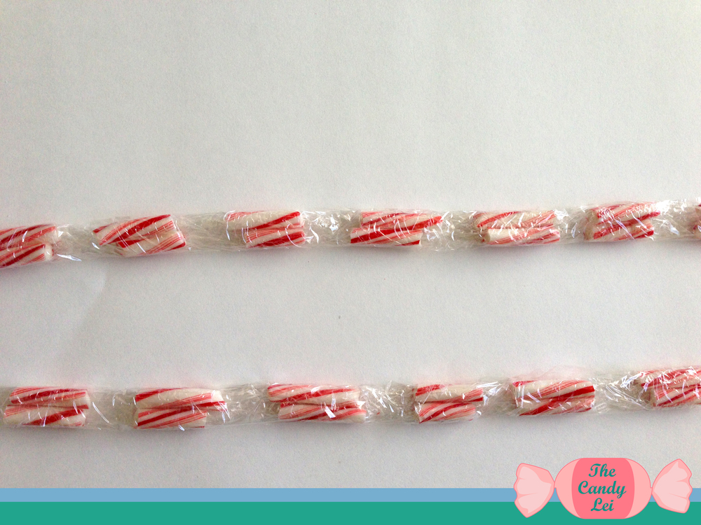 How to make a candy cane lei. The perfect Christmas Party accessory.