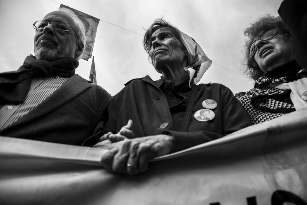 "A mother attends the 2000th round of the Mothers of Plaza de Mayo. They began walking in 1977 around the plaza every Thursday, next to the Casa Rosada in Buenos Aires, with the objective of recovering detained and ""disappeared"" people during the dictatorship."
