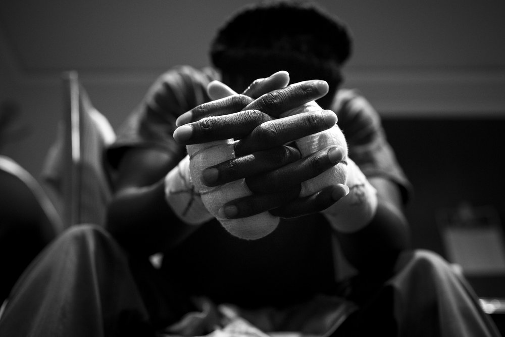 Tiara prays before her fight marking her professional debut as a fighter on September 30, 2016. She is a devoted Christian, and her religion is present in every aspect of her life.