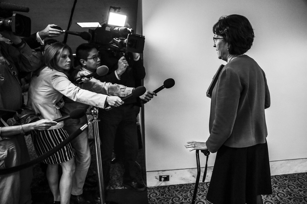 Senator Susan Collins takes questions from reporters in the Hart Senate Office Building.