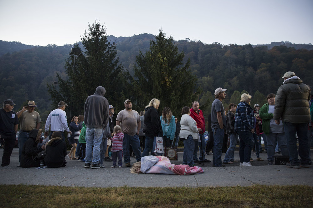 People wait to enter the Remote Area Medical (RAM) mobile clinic in Grundy, Virginia. This event was one of several weekend-long clinics held by RAM during the year, providing free dental, vision and general health services to hundreds of uninsured and underinsured people in remote areas of the US.