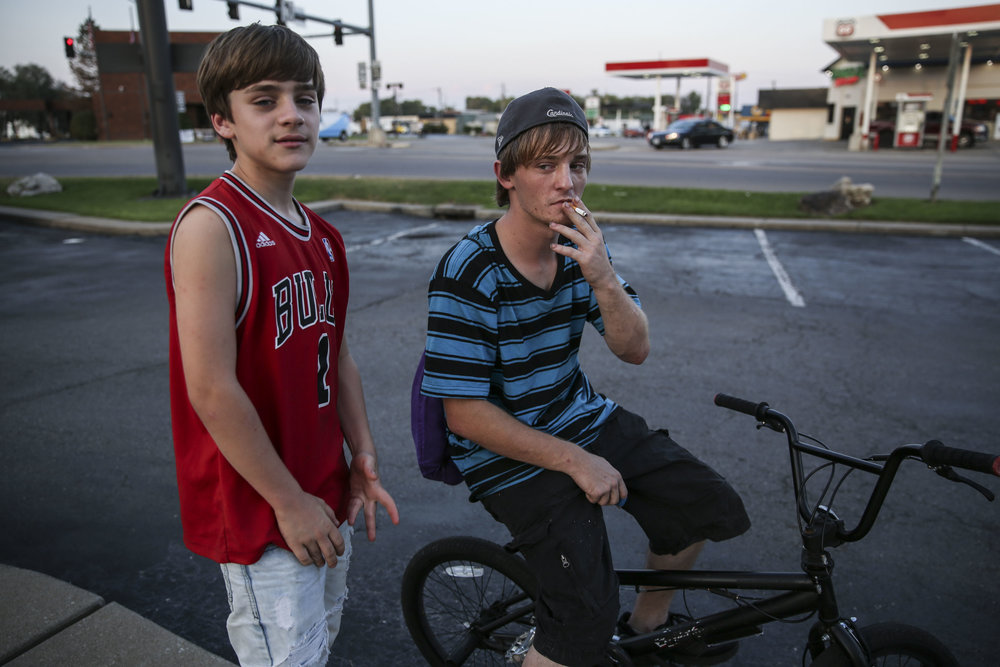 Dodge, 13, and Shawn, 20, hang out at McDonald's, where much of the town's youth spend time after school or late at night. Shawn currently lives in a tent in a friend's lawn, and hopes to rent an apartment next month.