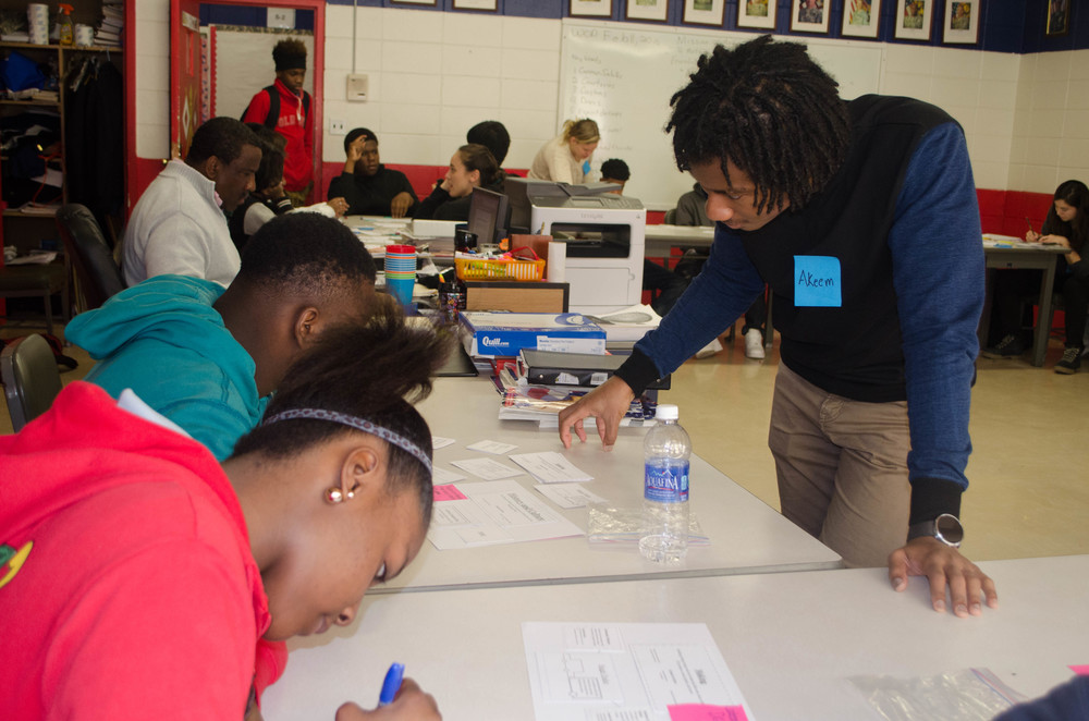 Doing a card-sorting co-design activity with Clarksdale youth at the Ombudsman high school.