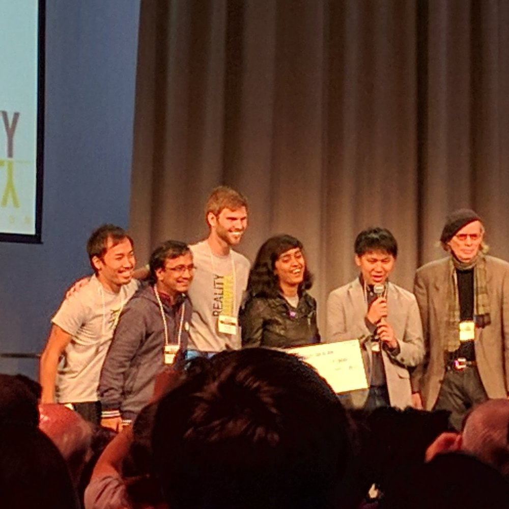 Adrian receiving award for Best Mobile VR App at a hackathon