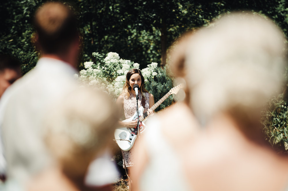 Crissi performing a love song request at a wedding ceremony in Windsor in 2017. The bride commissioned the song and included it in the ceremony as a surprise for her husband. Photo by Nicole Vallance Photography.