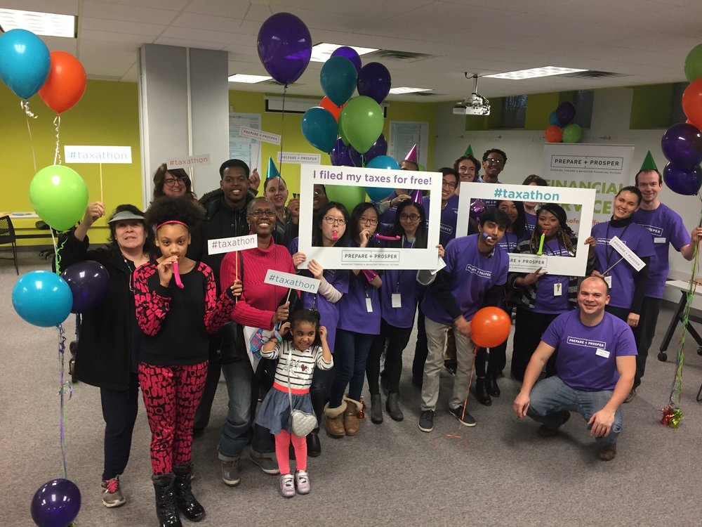 Celebration with customers, volunteers, and staff at the end of the taxathon.