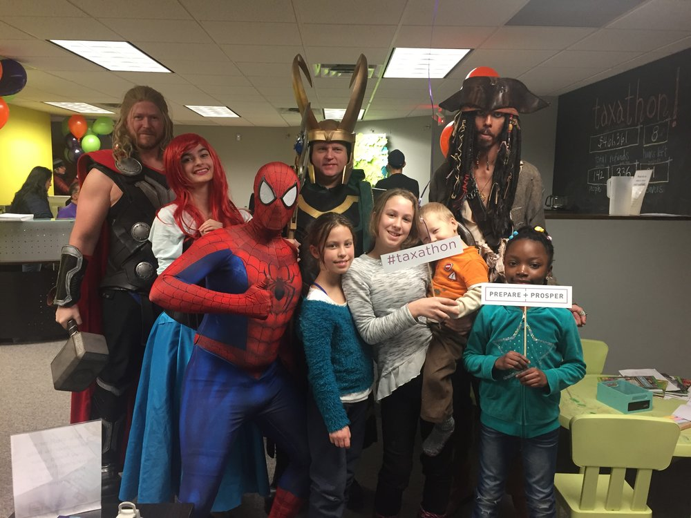 Superheros from a local community group stopped by to entertain kids on Saturday morning.