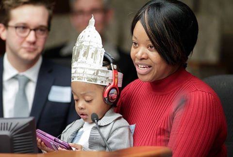 Kaleena, P+P customer, and her son testifying during a hearing for enhancing the Working Family Credit. photo: Minnesota House of Representatives