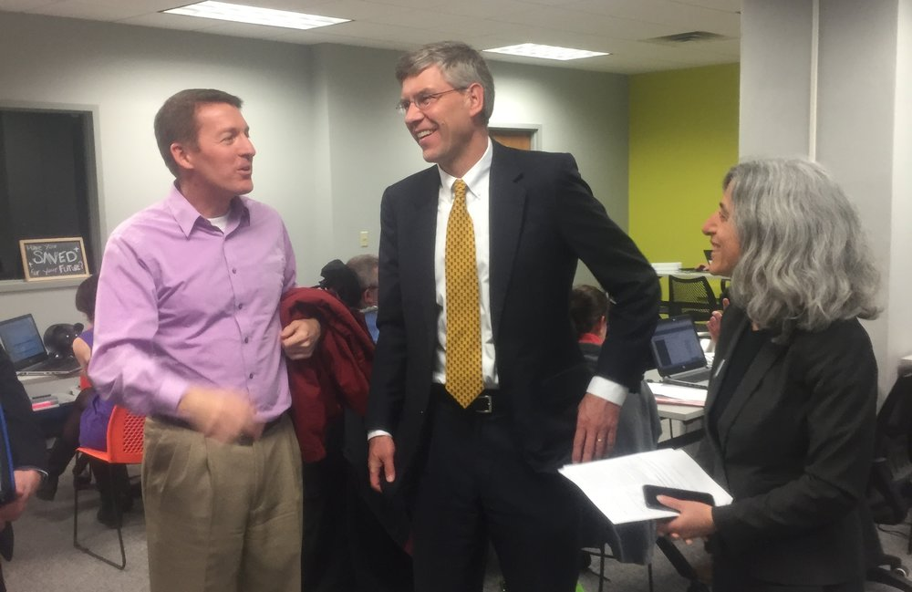 P+P volunteer Joe Bohlke and ED Tracy Fischman with Congressman Eric Paulsen at a tax clinic.