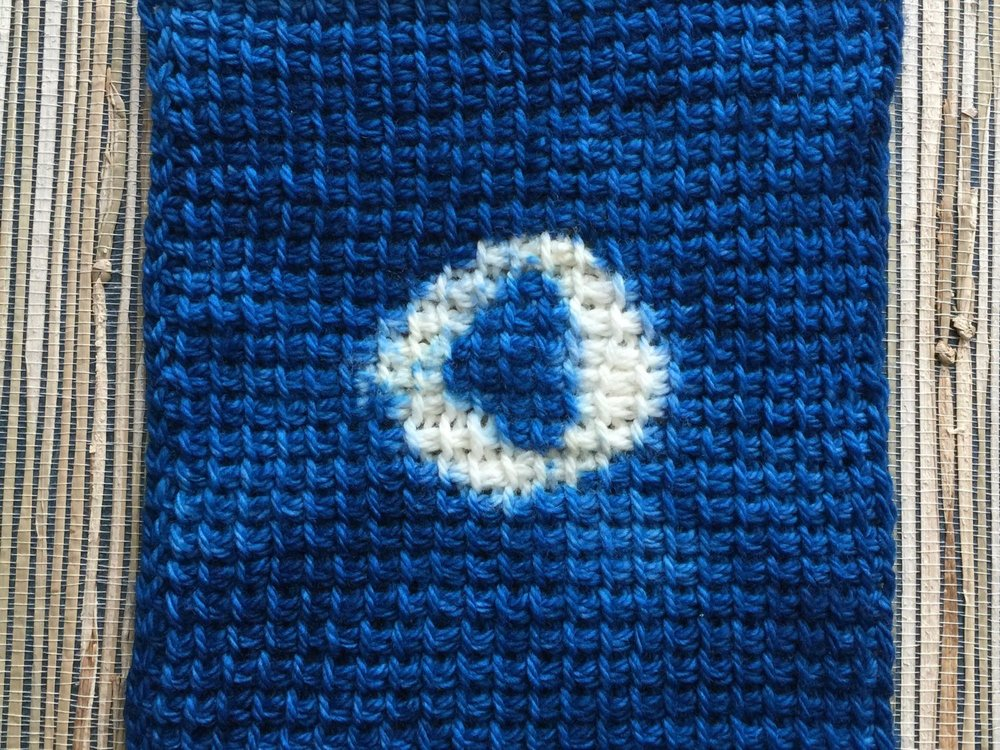 Shibori applied to crocheted swatch made of wool.