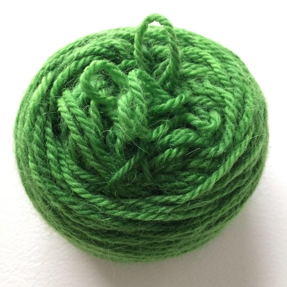 Alpaca-wool yarn dyed in greenery shade.