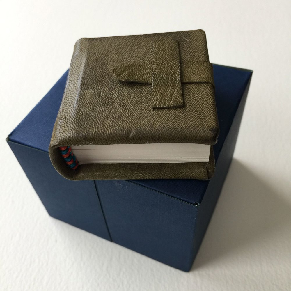 Miniature book bound in goat leather in olive shade