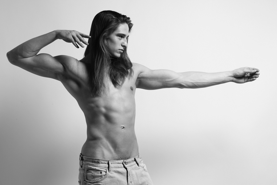 "Paul Corona   from   New York Models     HEIGHT: 6'1"" | WAIST: 32 | SHOE: 12 | HAIR: BROWN | EYES: BROWN   Photo by:   Dustin Mansyur   &   Marc Sifuentes   . Paul wears faded denim shorts by   Zara ."