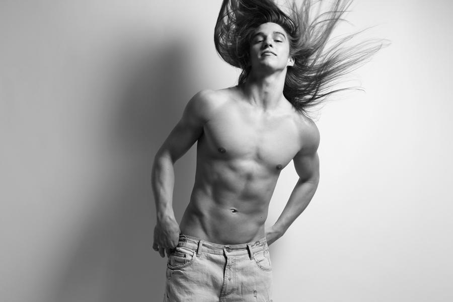 "Paul Corona   from   New York Models     HEIGHT: 6'1"" | WAIST: 32 | SHOE: 12 | HAIR: BROWN | EYES: BROWN   Photo by:   Dustin Mansyur   &   Marc Sifuentes   . Paul wears faded denim shorts by   Zara"