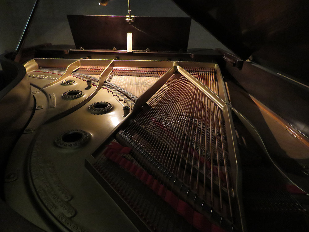 The intricacy of parts and pieces within a grand piano must be adjusted perfectly to create harmony.