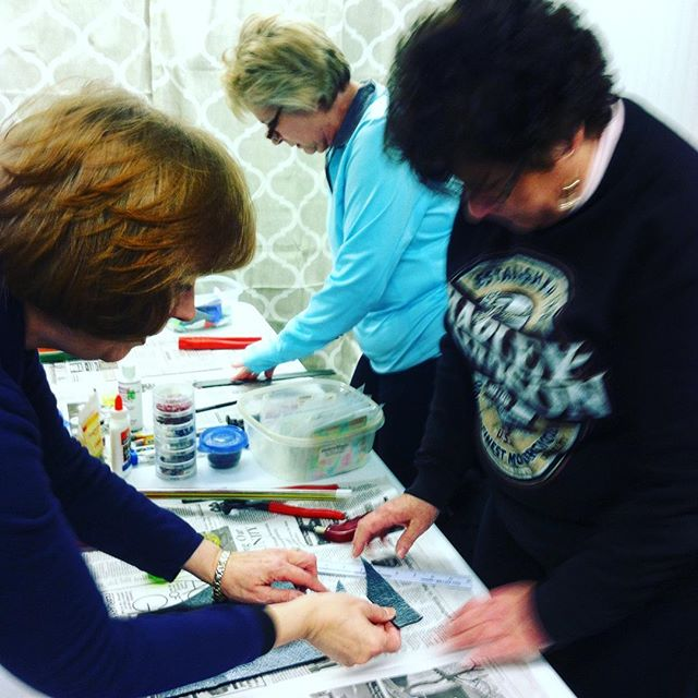 """Our Glass Fusing class hard at work, """"cutting it up""""! 😄😂"""