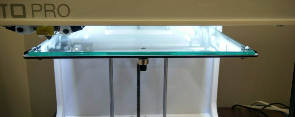 3.  Clip  the glass bed onto the main platform