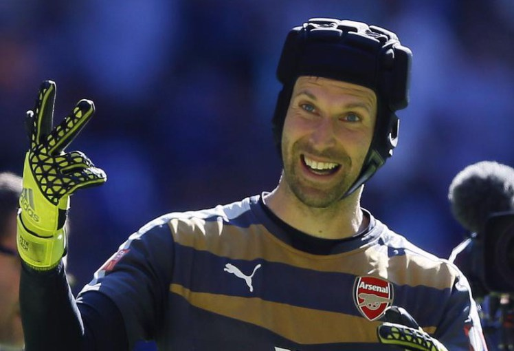 Plus, he wears a fun hat! PHOTO: http://metro.co.uk/2015/08/03/arsenal-fans-troll-chelsea-supporters-with-petr-cech-is-a-gooner-chant-5325083/