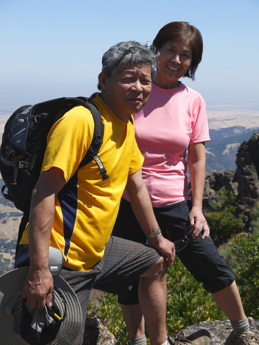 Masato and Yoko Suzuki grin and bear the trudge up North Peak Trail, Mt. Diablo.
