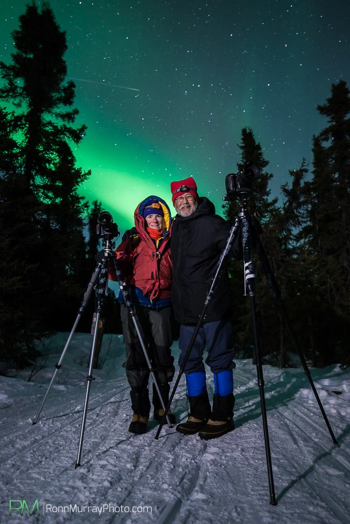 Margaret and Paul Hara stalk the auroras near Fairbanks, Alaska. Photo by Ronn Murray.