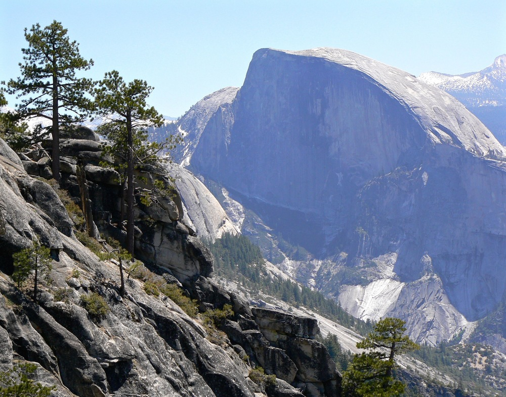 Viewed from Yosemite Point in late morning, the face of Half Dome is veiled in shadow.