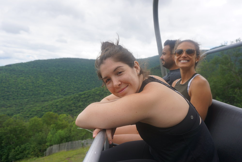 Nora, Jenn and Marcos riding the chairlift down after hiking to the top!