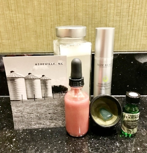 Some nontoxic travel beauty essentials while in Asheville, NC (clockwise from front:  D.I.D. with Cazoshay Monokeros Love Rose Quartz Serum ,  D.I.D. with Cazoshay Aventurine Matcha Love Balm ,  Needful Things Battle Better ,  Juice Beauty Stem Cellular Exfoliating Peel Spray, Nontoxic Face Wash+Makeup Remover