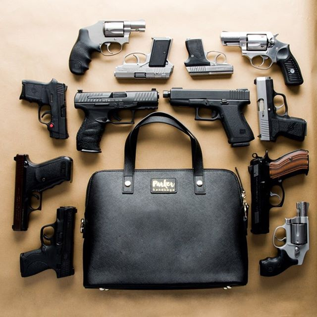 """No. 1 most frequently asked question: """"what size gun will fit in a Parker Handbag?"""". This was such a fun picture to take because the answer includes more guns than we could fit in a picture! Any mid size, short barrel handgun will fit flawlessly. There are so many different guns on the market I was only able to include a few, but all of these were tested and fit. What is more important is the same as with any new concealment choice: practice, practice, practice! #parkerhandbags #safetyfirst #girlswhocarry"""