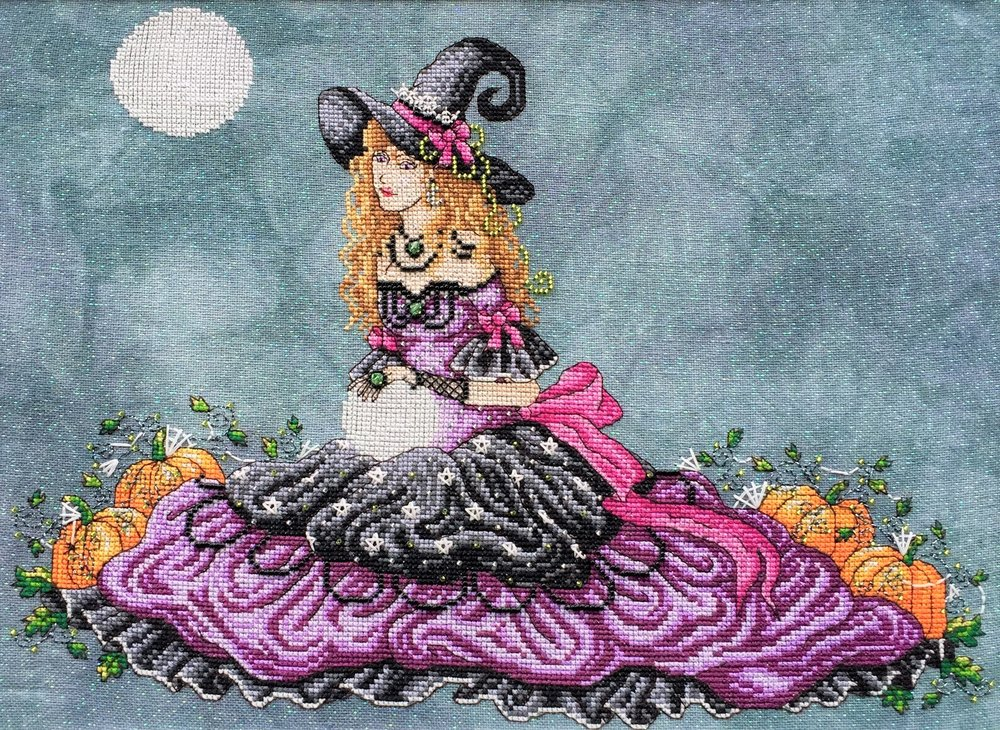 Luna, stitched on 32 count Crystal Haunted by Picture this Plus fabrics using DMC, Kreinik and Mill Hill beads. ©Shannon Wasilieff, 2017