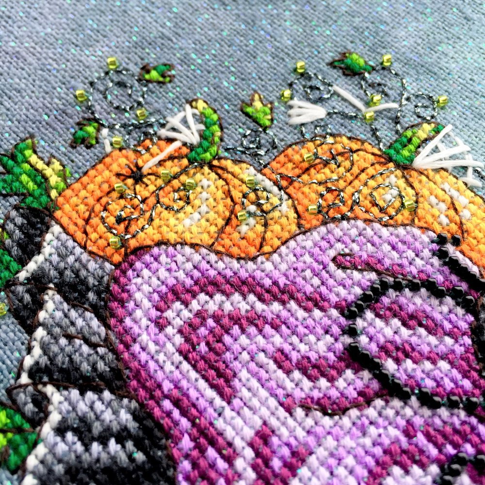 Close up of pumpkins on Luna, stitched on 32 count Crystal Haunted by Picture this Plus fabrics using DMC, Kreinik and Mill Hill beads. ©Shannon Wasilieff, 2017