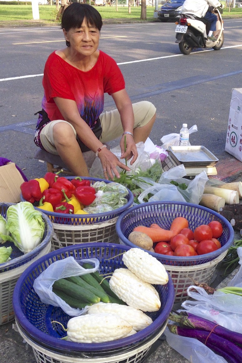 Fresh veggies are frequently sold by local farmers on the streets of Kaohsiung.