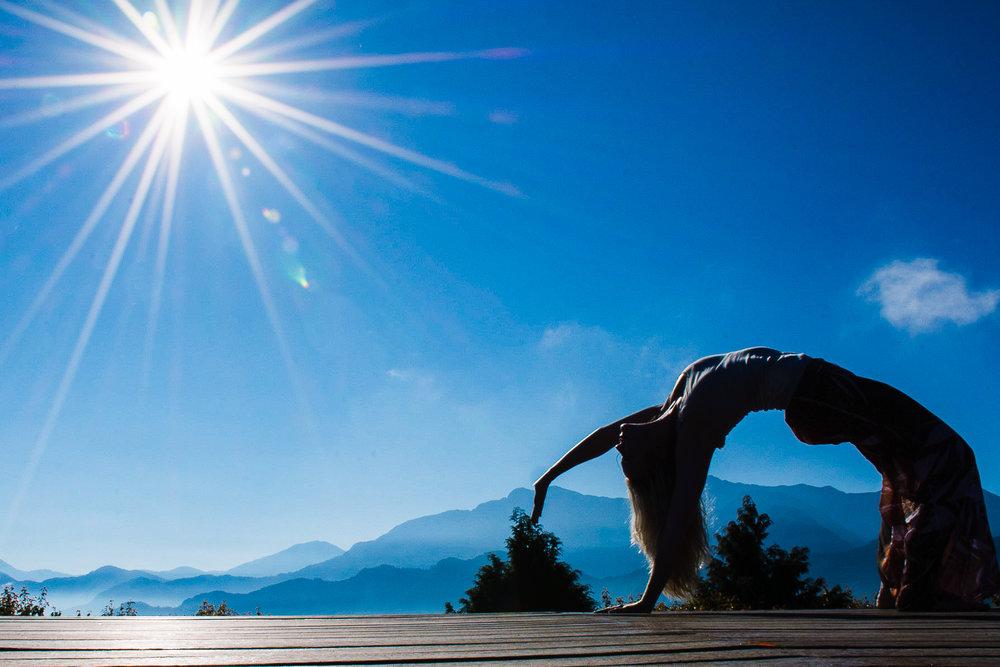 On a mountain in Taiwan doing yoga.
