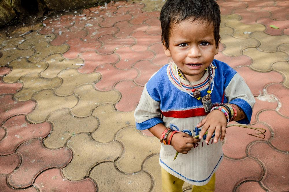 Poor boy in Mumbai, India