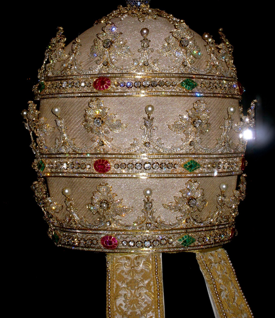 Tiara of Pius IX, (Reigned 1846–78); 1854 cloth of silver embroidered with gold metal thread, gold, diamonds, rubies, sapphires, emeralds, and pearls.