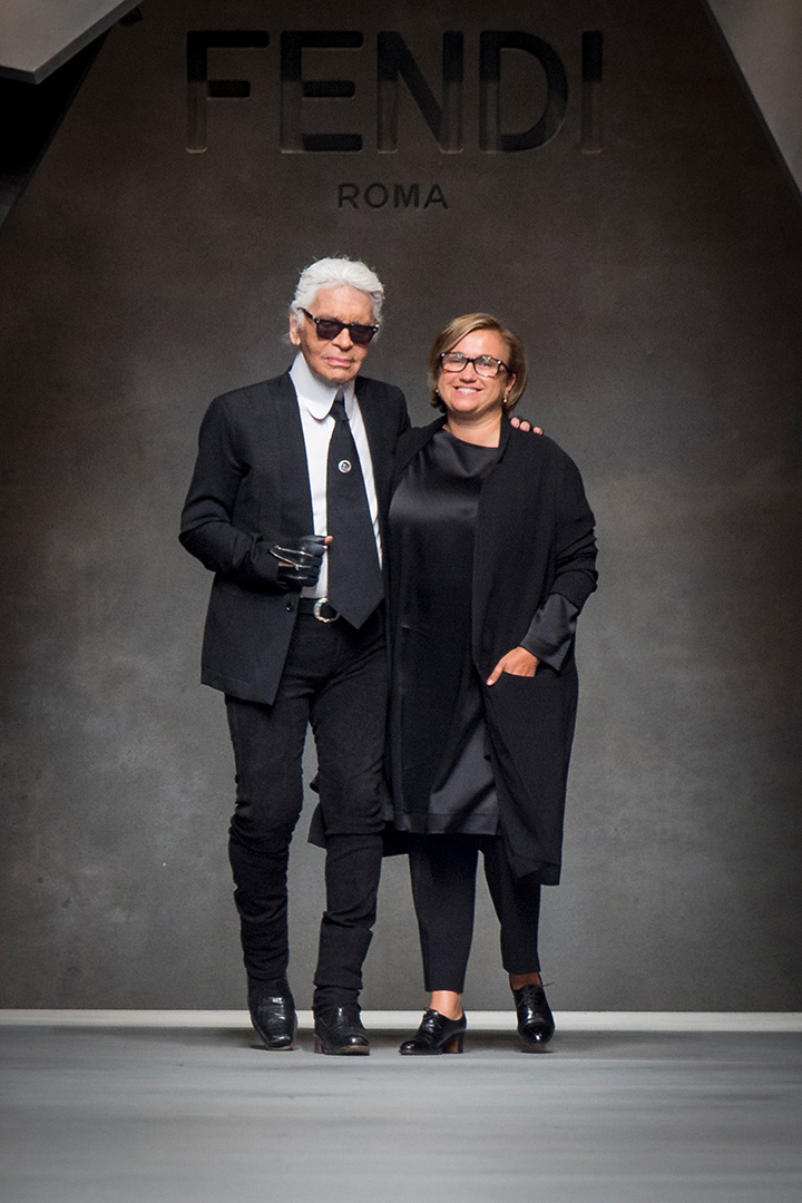 Taking a bow with Silvia Venturini Fendi. Lagerfeld tenure at Fendi is the longest-lasting relationship a designer's had with a brand which in 2015 celebrated its 50th anniversary.