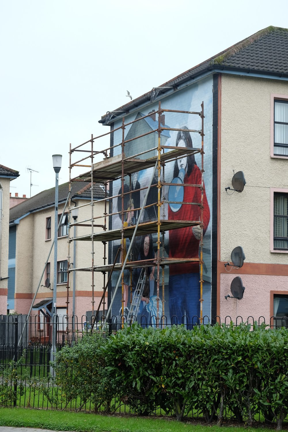 Under renovation when we were in Derry was the famous mural depicting Bernadette Devlin addressing the crowds on the streets of the Bogside. At age 21, she was the youngest MP ever elected to Parliament at the time, and she was convicted of incitement to riot in December 1969.