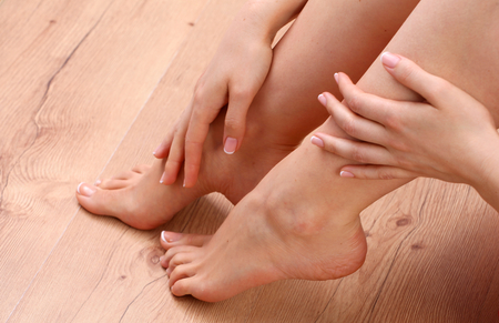 44072180_S_feet_check_woman_hands_indoors_manicure_touch_rub_high_arch.jpg