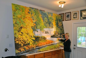 Karen at her home studio in Williamston, working on her triptych.