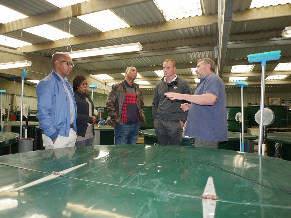 At the Institute's Buckieburn salmonid    experimental   trial facility   with Manager Alistair McPhee