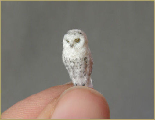 One of the earliest drawings was of a family of Snowy Owls painted on the wall of a cave in France dating back 30, 000 years to the early Paleolithic period. In more recent times the snowy owl remains a much loved and enchanting figure in popular culture as Hedwig in Harry potter.    Scale: 1:24    Medium: Polymer clay and feather plumage sculpture with glass eyes and wire feet.    Prices for 1:24 scale for snowy owls start from £70.00 depending on the pose of the sculpture. Price includes postage within the UK.    Year: 2011