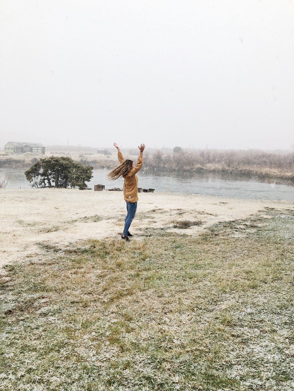 frolicking in the snow makes for one happy montana girl who loves being outside