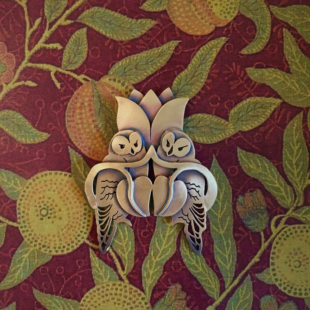 Pair of owls in brass
