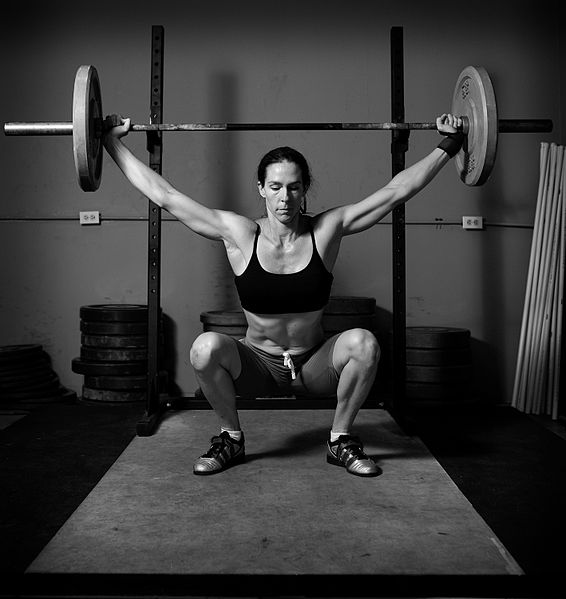 566px-Weight_lifting_black_and_white