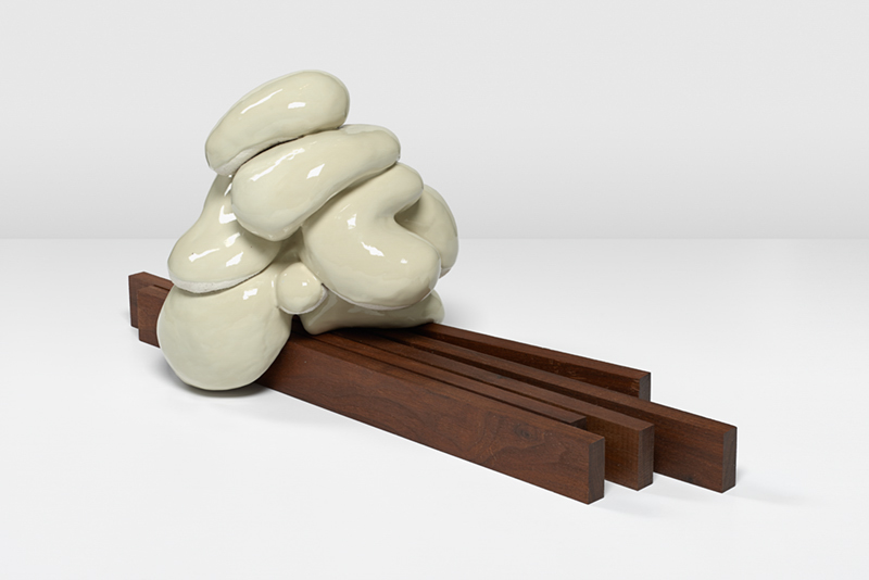 Political Riddle , 2014  Glazed ceramic, walnut  11 x 22 x 11 in