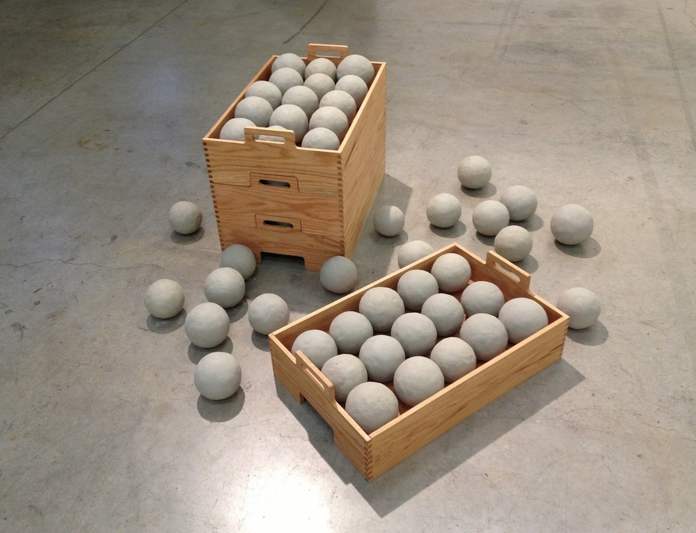 "77 Dumbballs for Ken Price , 2013  Unfired clay & oak  ""The Long Conversation""  Southern Exposure"
